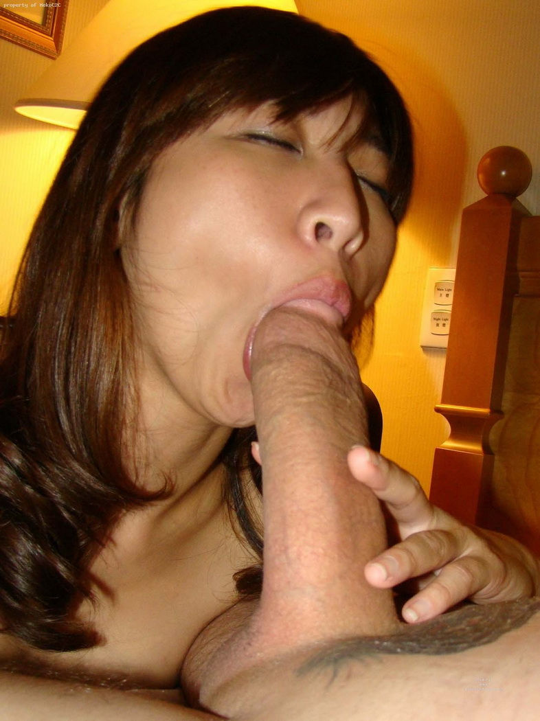 Asian milf sucks white cock