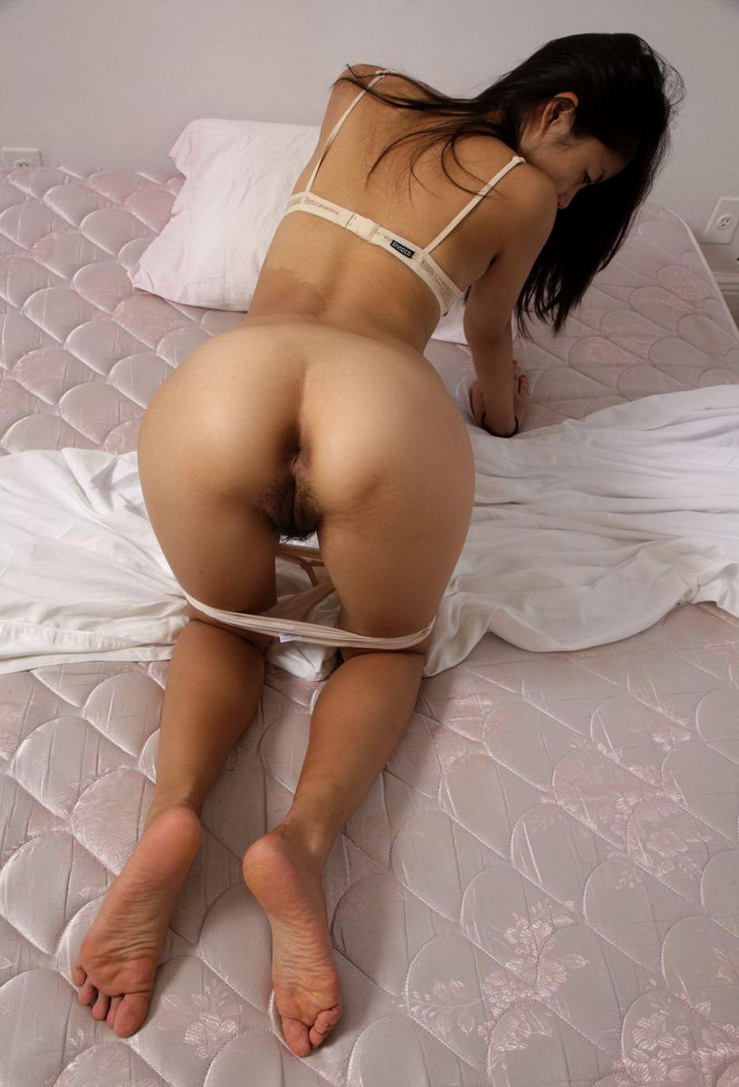 Asian girls in bed wearing panties