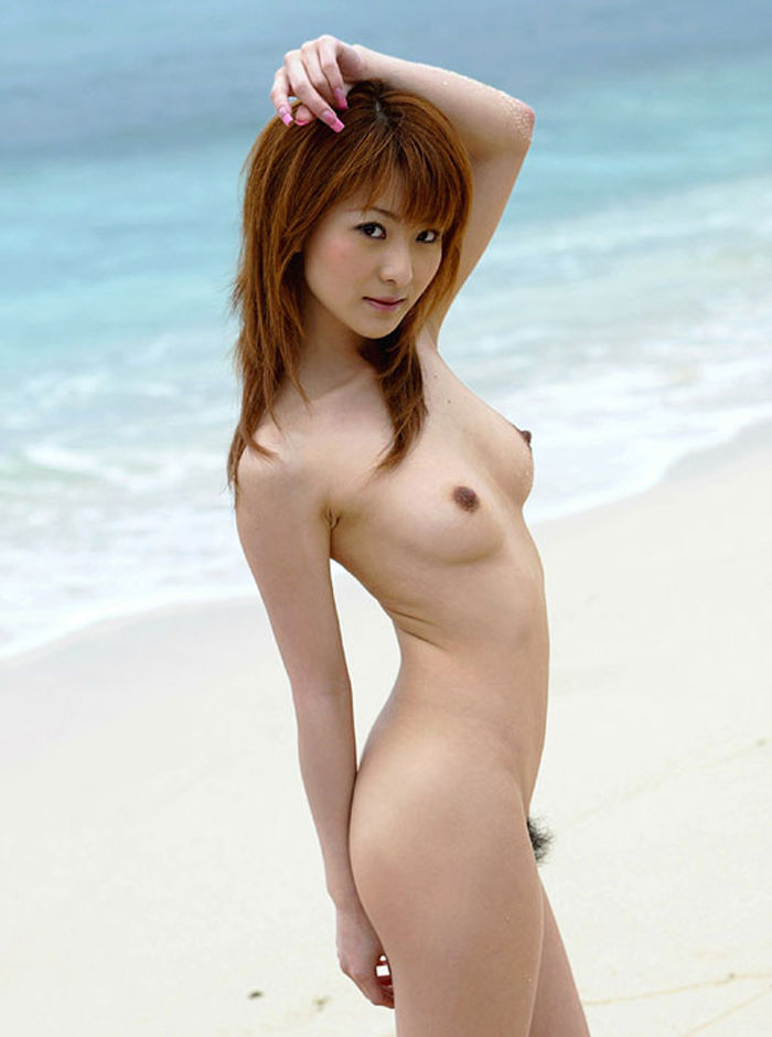 Red-hair Asian bitch has taken off her clothes to pose nude on the beach.jpg