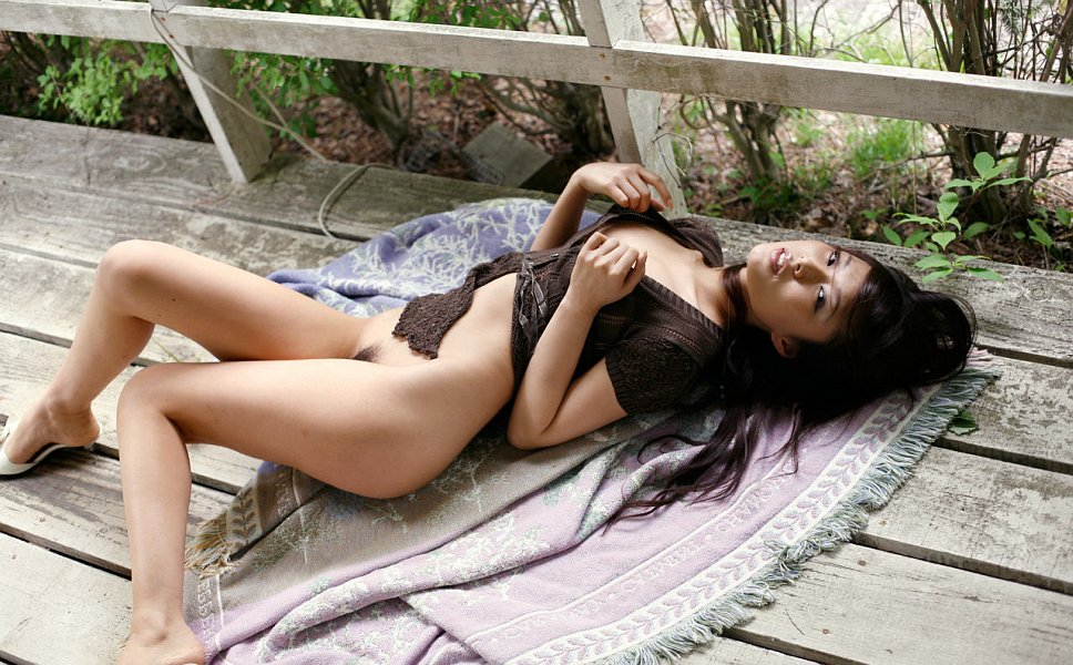 Japanese super-model with hot body posing outdoors. 16 photos